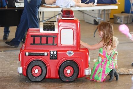 Photo of children with robotic fire engine